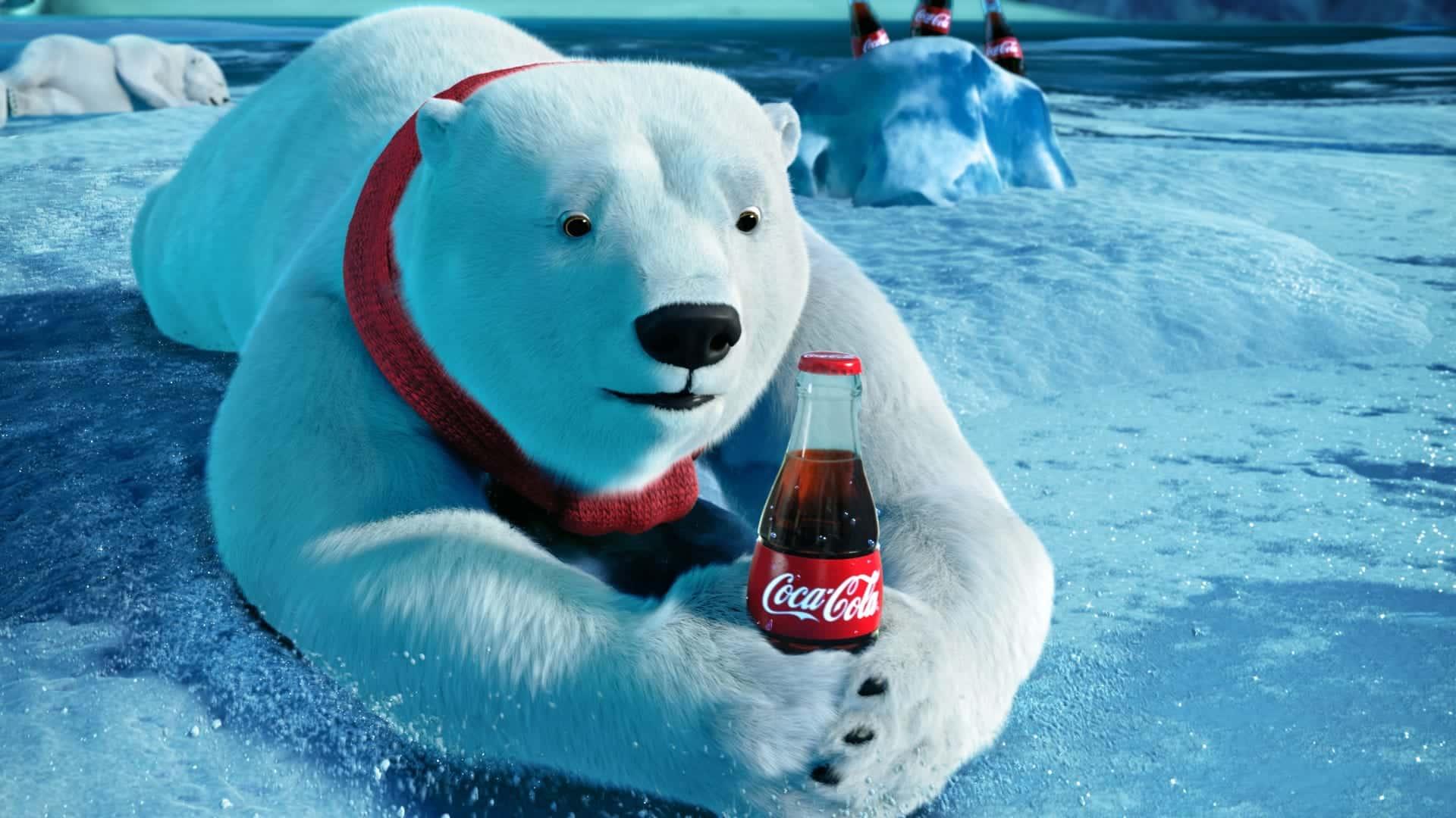 Força da marca - Urso Polar bebendo Coca-Cola - 13 estrategias para atrair clientes com imagens